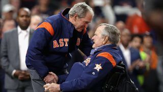 HOUSTON, TX - OCTOBER 29: Former United States Presidents George H.W. Bush and George W. Bush prepare to throw out the ceremonial first pitch before in game five of the 2017 World Series at Minute Maid Park on October 29, 2017 in Houston, Texas.   Christian Petersen/Getty Images/AFP