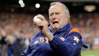 HOUSTON, TX - OCTOBER 29: Former United States president George H.W. Bush prepares to throw out a ceremonial first pitch before game five of the 2017 World Series between the Houston Astros and the Los Angeles Dodgers at Minute Maid Park on October 29, 2017 in Houston, Texas.   David J. Phillip - Pool/Getty Images/AFP