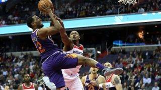 WASHINGTON, DC - NOVEMBER 01: TJ Warren #12 of the Phoenix Suns is fouled by Bradley Beal #3 of the Washington Wizards during the second half at Capital One Arena on November 01, 2017 in Washington, DC. NOTE TO USER: User expressly acknowledges and agrees that, by downloading and or using this photograph, User is consenting to the terms and conditions of the Getty Images License Agreement.   Patrick Smith/Getty Images/AFP