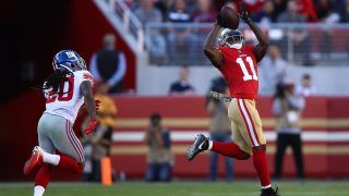 SANTA CLARA, CA - NOVEMBER 12: Marquise Goodwin #11 of the San Francisco 49ers makes a catch on his way to against the New York Giants83-yard touchdown against the New York Giants during their NFL game at Levi's Stadium on November 12, 2017 in Santa Clara, California.   Ezra Shaw/Getty Images/AFP