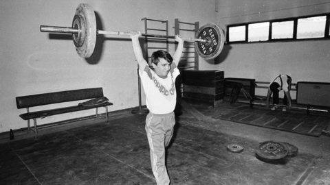 ANKARA, TURKEY - (ARCIHIVE): (EDITORS NOTE: Image has been shot in black and white. Color version not available) A file photo dated February 01, 1989 shows World and Olympic champion in weightlifting, Naim Suleymanoglu (2nd R) of Turkey, lifting during a exercise session prior to Balkan Championship, in Ankara, Turkey on  February 01, 1988. Bulgaria-born Turkish weightlifter Naim Suleymanoglu set his first world record in 1982 and then won gold medals, at Seoul Olympics in 1988, at Barcelona Olympics in 1992 and at Atlanta Olympics in 1996. Naim Suleymanoglu has died at the age of 50, on November 18, 2017.  Ilhan Kuyucu  / Anadolu Agency