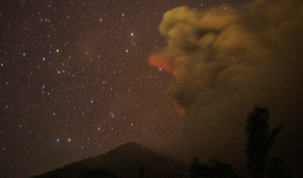 BALI, INDONESIA - NOVEMBER 26: A bright red sky is seen from Besakih village of Karangasem regency, 7 kilometers from the erupted Mount Agung in Bali, Indonesia on November 26, 2017. Mount Agung still erupt and spew ash, sand, rock and gas to the sky. Mount Agung last fatal eruption was on 1963, which caused more than 1.500 casualties.  Mahendra Moonstar / Anadolu Agency
