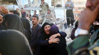 KERMANSHAH, IRAN - NOVEMBER 13: Earthquake survivors who had lost their relatives cry next to the debris of buildings at Sarpol-e Zahab province of Kermanshah, Iran on November 13, 2017 following a 7.3 magnitude earthquake that hit the Iraq and Iran. An earthquake measuring 7.3 on the Richter scale rocked northern Iraq and Iran, the U.S. Geological Survey said on Sunday evening. At least 341 died and 5,953 others were injured in Iran's bordering regions, especially in Kermanshah province in west.