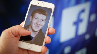 A portrait of Facebook found Mark Zuckerberg is seen on an iPhone in this photo illustration on 28 August, 2017. (Photo by Jaap Arriens/NurPhoto)