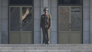 A North Korean soldier stands guard in the border village of Panmunjom between South and North Korea at the Demilitarized Zone (DMZ) on October 14, 2017 in Panmunjom, South Korea. North Korea renewed its threats to launch ballistic missiles around the U.S. Territory of Guam. (Photo by Yichuan Cao/NurPhoto)