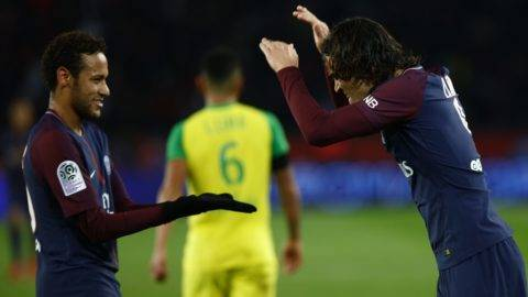 Paris Saint-Germain's Uruguayan forward Edinson Cavani (R) celebrates with Paris Saint-Germain's Brazilian forward Neymar after scoring his team's 4th goal during the French L1 football match between Paris Saint-Germain (PSG) and Nantes (FCN) at the Parc des Princes stadium in Paris on November 18, 2017. (Photo by Mehdi Taamallah/NurPhoto)