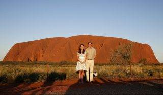 AYERS ROCK, AUSTRALIA - APRIL 22:  Catherine, Duchess of Cambridge and Prince William, Duke of Cambridge pose in front of Uluru, also known as Ayers Rock, on April 22, 2014 in Ayers Rock, Australia. The Duke and Duchess of Cambridge are on a three-week tour of Australia and New Zealand, the first official trip overseas with their son, Prince George of Cambridge. (Photo by Phil Noble - WPA Pool/Getty Images)