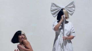 LAS VEGAS, NV - OCTOBER 07:  Dancer Maddie Ziegler (L) and recording artist Sia perform during a stop of Sai's Nostalgic for the Present tour at the Mandalay Bay Events Center on October 7, 2016 in Las Vegas, Nevada.  (Photo by Bryan Steffy/Getty Images)