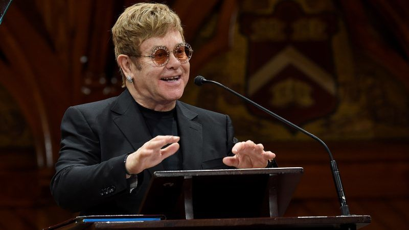 CAMBRIDGE, MA - NOVEMBER 06:  EJAF founder Elton John presents onstage as he accepts the Peter J. Gomes Humanitarian of the Year Award from the Harvard Foundation for his work towards ending AIDS at Sanders Theatre on November 6, 2017 in Cambridge, Massachusetts.  (Photo by Michael Kovac/Getty Images for Elton John AIDS Foundation)