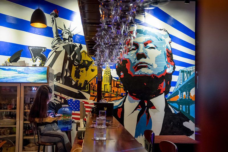 "DANANG, VIETNAM - NOVEMBER 09: The 5-month old bar named after U.S. President Donald Trump is seen on November 9, 2017 in Danang, Vietnam. Nguyen Ha Anh Tuan, 32 - owner of Trump Bar, states that he likes Trump's turbulence and he wants to bring that spirit to his bar. According to Tuan, naming his bar after the U.S President is ""an wise marketing move"". U.S. President Donald Trump, who is on a 12-day Asia trip, will take part in the Asia-Pacific Economic Cooperation summit hosted by Vietnam this year. The APEC leaders meeting, which opens on Friday in Danang, Vietnam, aims to promote free trade throughout the Asia-Pacific region.  (Photo by Linh Pham/Getty Images)"