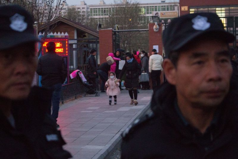 Parents holding their kinds walk out of the RYB Education New World kindergarten after parents accused RYB Kindergarten of abusing their children in Beijing, China, 24 November 2017.  A female teacher was detained Saturday (25 November 2017) on suspicion of child abuse at a Beijing kindergarten, according to local police. Beijing police said the teacher surnamed Liu, 22, was detained on suspicion of child abuse at the RYB Education New World kindergarten in Chaoyang District. On Wednesday, Beijing police received reports that pre-school children at the kindergarten had been abused. Several teachers at the kindergarten were suspended from duty Thursday, pending a police investigation in the child abuse claims. Police said they had performed forensic tests and obtained surveillance footage for the investigation.