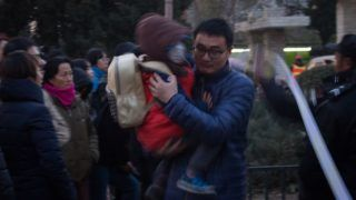 A father carrying his kid walks out of the RYB Education New World kindergarten after parents accused RYB Kindergarten of abusing their children in Beijing, China, 24 November 2017.  A female teacher was detained Saturday (25 November 2017) on suspicion of child abuse at a Beijing kindergarten, according to local police. Beijing police said the teacher surnamed Liu, 22, was detained on suspicion of child abuse at the RYB Education New World kindergarten in Chaoyang District. On Wednesday, Beijing police received reports that pre-school children at the kindergarten had been abused. Several teachers at the kindergarten were suspended from duty Thursday, pending a police investigation in the child abuse claims. Police said they had performed forensic tests and obtained surveillance footage for the investigation.