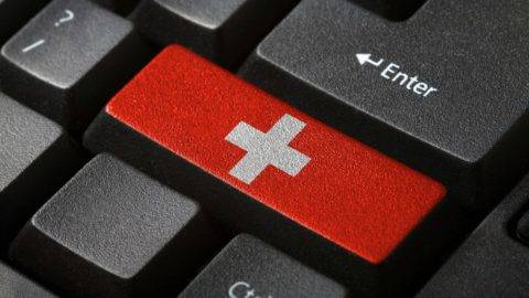 The Swiss flag button on the keyboard. close-up