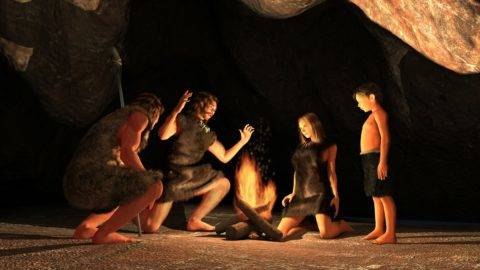 Cave dwellers gathered around a campfire