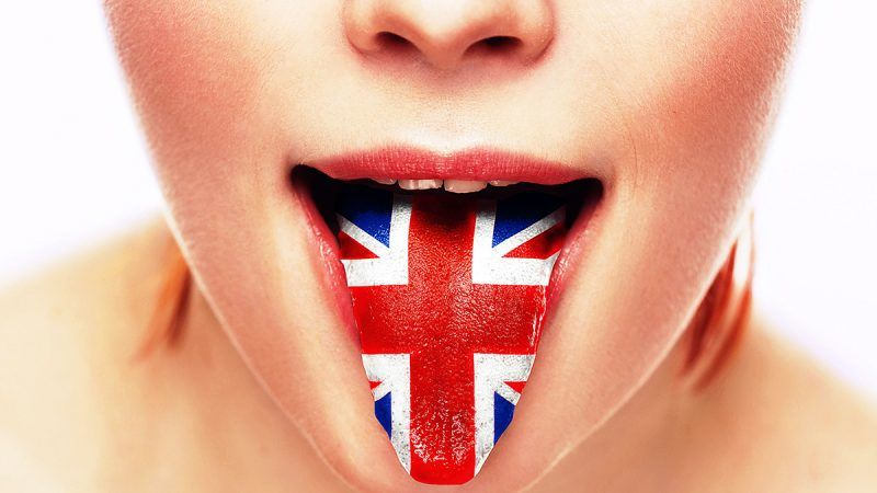 English language tongue open mouth with flag Britain woman face. Studio shot.