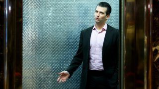 """(FILES):  This file photo taken on November 17, 2016 shows Donald Trump Jr, arriving at Trump Tower for meetings with US President-elect Donald Trump in New York.  President Donald Trump's son released Monday, November 13, 2017 a series of messages he had with WikiLeaks after a report suggested he had secretly liaised with the group which published Hillary Clinton's emails during last year's election. Donald Trump Jr revealed what he said was the """"entire"""" chain of Twitter direct messages with WikiLeaks between September 2016 and July this year, in which the anti-secrecy group sought to feed information to the Trump campaign and enhance the impact of its Clinton releases. / AFP PHOTO / Eduardo Munoz Alvarez"""