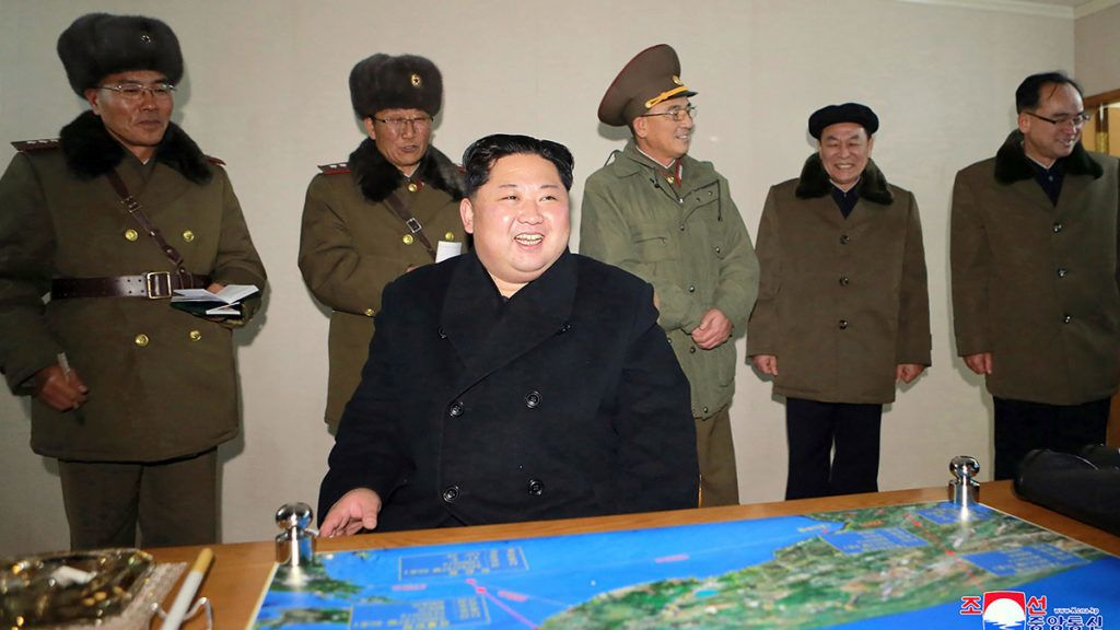"""This photo taken on November 29, 2017 and released on November 30, 2017 by North Korea's official Korean Central News Agency (KCNA) shows North Korean leader Kim Jong-Un looking at launching of the Hwasong-15 missile which is capable of reaching all parts of the US. / AFP PHOTO / KCNA via KNS / KCNA VIA KNS / South Korea OUT / REPUBLIC OF KOREA OUT   ---EDITORS NOTE--- RESTRICTED TO EDITORIAL USE - MANDATORY CREDIT """"AFP PHOTO/KCNA VIA KNS"""" - NO MARKETING NO ADVERTISING CAMPAIGNS - DISTRIBUTED AS A SERVICE TO CLIENTSTHIS PICTURE WAS MADE AVAILABLE BY A THIRD PARTY. AFP CAN NOT INDEPENDENTLY VERIFY THE AUTHENTICITY, LOCATION, DATE AND CONTENT OF THIS IMAGE. THIS PHOTO IS DISTRIBUTED EXACTLY AS RECEIVED BY AFP.  / """"The erroneous mention[s] appearing in the metadata of this photo by KCNA VIA KNS has been modified in AFP systems in the following manner: [Hwasong-15 missile] instead of [Hwansong-15 missile]. Please immediately remove the erroneous mention[s] from all your online services and delete it (them) from your servers. If you have been authorized by AFP to distribute it (them) to third parties, please ensure that the same actions are carried out by them. Failure to promptly comply with these instructions will entail liability on your part for any continued or post notification usage. Therefore we thank you very much for all your attention and prompt action. We are sorry for the inconvenience this notification may cause and remain at your disposal for any further information you may require."""""""