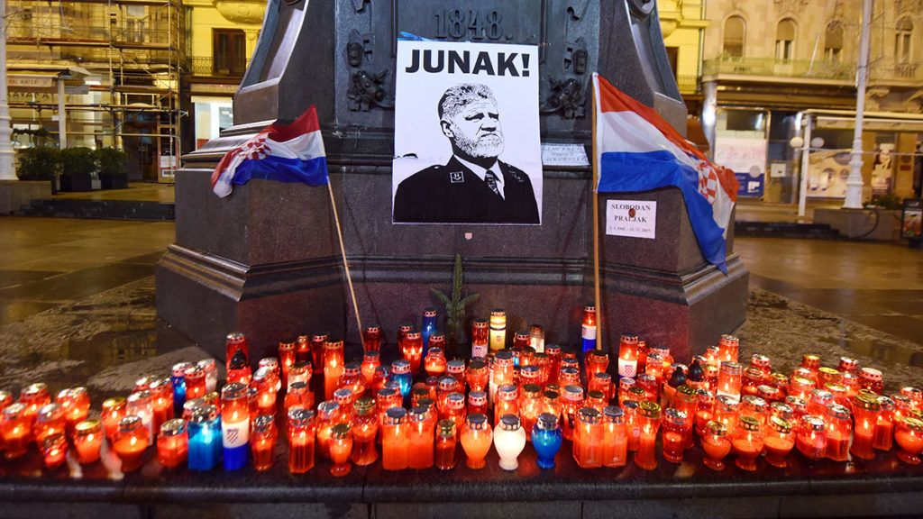 Lit candles and flags are placed in tribute to General Slobodan Praljak in Zagreb on November 30, 2017, after the Bosnian Croat war criminal took his own life in front of United Nations war crimes judges, apparently drinking poison just after they upheld his 20-year jail term for atrocities committed during the Balkans conflict. Croatia's president said on November 30 that citizens had to admit crimes were committed by fellow Croats during the 1990s conflict in Bosnia, a day after a Bosnian Croat war criminal took his own life at a court in The Hague. / AFP PHOTO / STRINGER