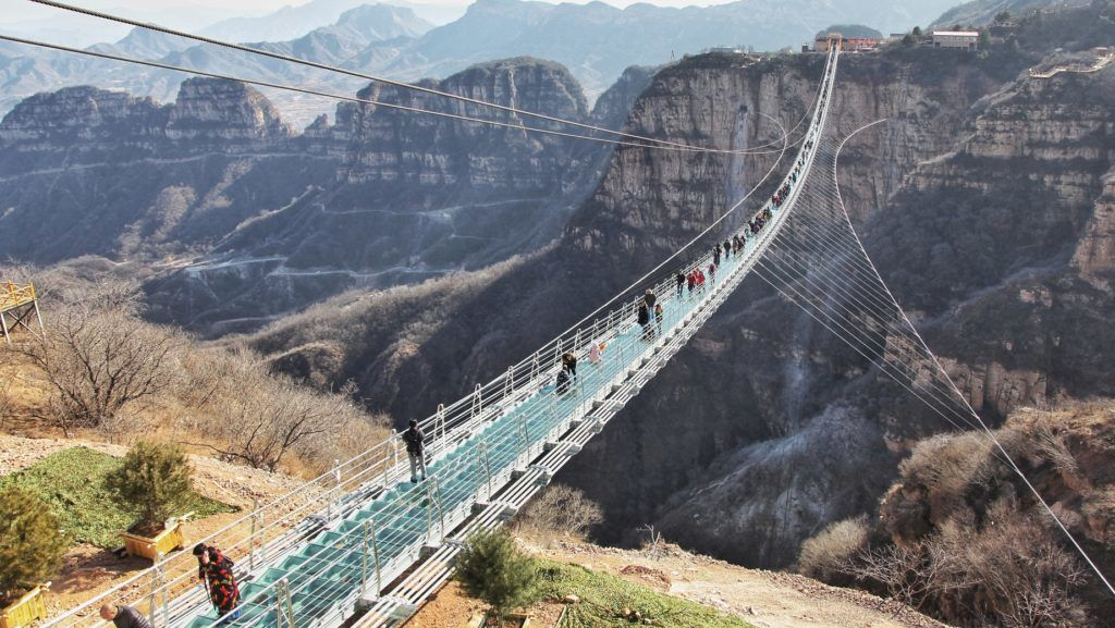 General view of the world's longest glass suspension bridge at Hongyagu scenic spot in Pingshan county, Shijiazhuang city, north China's Hebei province, 24 December 2017.   Tourists walked on the glass suspension bridge at Hongyagu scenic spot in Pingshan County, north China's Hebei Province, 24 December 2017. The 488-meter-long world's longest glass suspension bridge was formally open to the public Sunday.