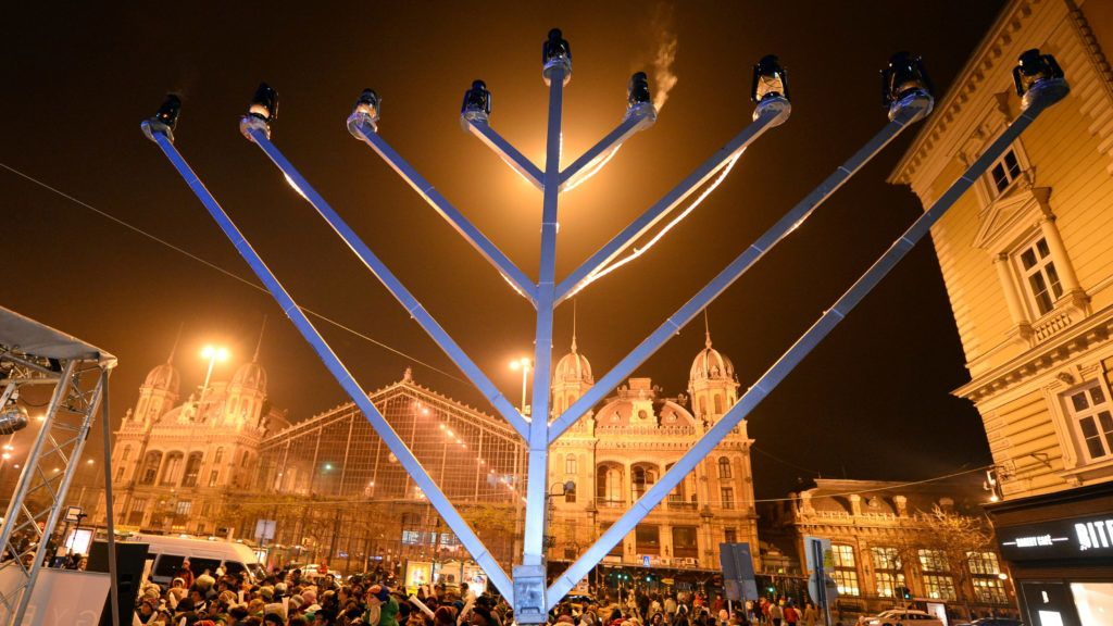 A giant Menorah, a nine-branched candelabrum is seen on the last day of the eight-day Jewish festival of lights, the Hanukkah, at Nyugati square of Budapest in front of the building of Westend railway station, a construction of French arhitecht Gustave Eiffel  on December 4, 2013. AFP PHOTO / ATTILA KISBENEDEK / AFP PHOTO / ATTILA KISBENEDEK