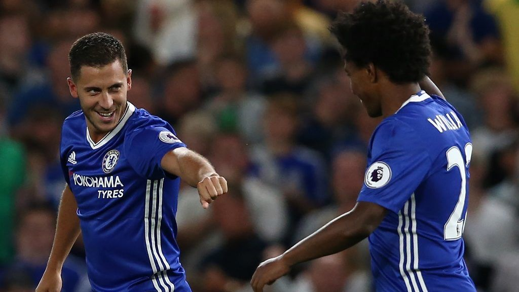 Chelsea's Belgian midfielder Eden Hazard (L) celebrates with Chelsea's Brazilian midfielder Willian (R) after scoring the opening goal from the penalty spot during the English Premier League football match between Chelsea and West Ham United at Stamford Bridge in London on August 15, 2016. / AFP PHOTO / Justin TALLIS / RESTRICTED TO EDITORIAL USE. No use with unauthorized audio, video, data, fixture lists, club/league logos or 'live' services. Online in-match use limited to 75 images, no video emulation. No use in betting, games or single club/league/player publications.  /