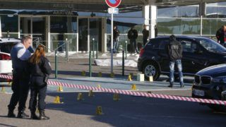 Forensic police work at the scene of a deadly shooting near the body of Antoine Quilichini, aka Tony le boucher (Tony the butcher), who is on police record for organised crime, outside the airport of Bastia, on the French Mediterranean island of Corsica, on December 5, 2017. The shooting took place in a car park near the entrance of Bastia airport in the north of the Mediterranean island, leaving Quilichini dead with a gunshot to the head, another with several bullet wounds and a third with minor injuries. / AFP PHOTO / PASCAL POCHARD-CASABIANCA