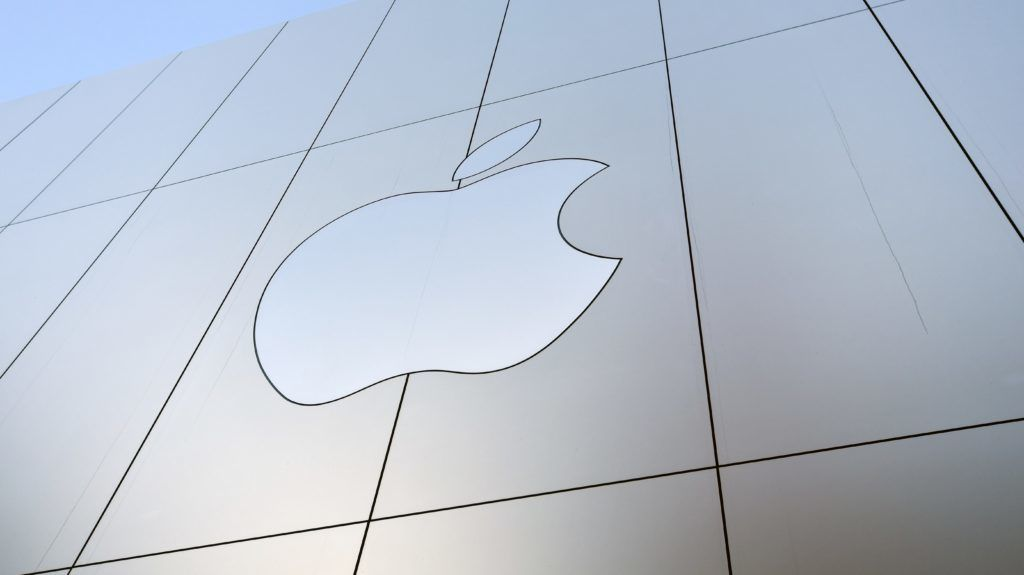 "(FILES) This file photo taken on September 22, 2017 shows an Apple logo on the outside of an Apple store in San Francisco, California.  Apple will buy leading song recognition app Shazam, the companies said on December 11, 2017, in a fresh bid by the tech giant to gain an edge in online music.""Apple Music and Shazam are a natural fit, sharing a passion for music discovery and delivering great music experiences to our users,"" Apple said in a statement without disclosing financial terms.  / AFP PHOTO / Josh Edelson"
