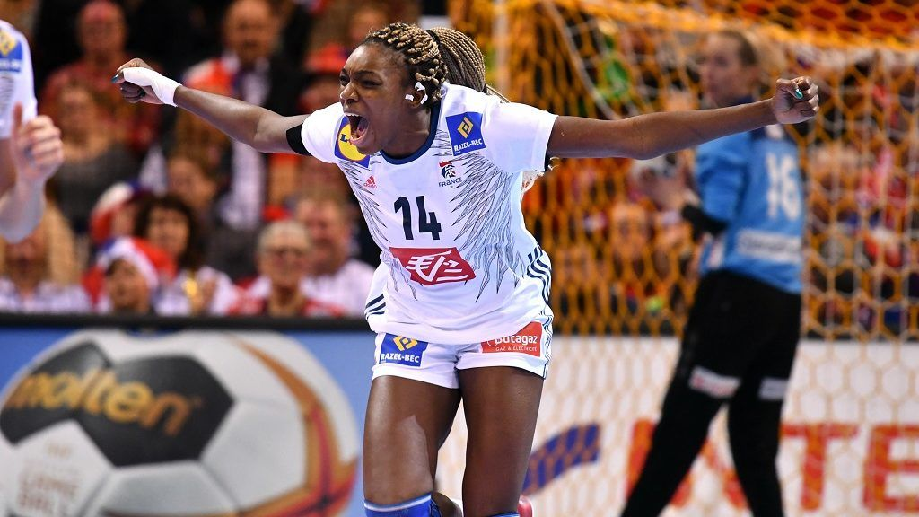 France's Kalidiatou Niakate reacts after scoring during the IHF Women's World Championship handball final match between France and Norway on December 17, 2017 in Hamburg, nothern Germany. / AFP PHOTO / PATRIK STOLLARZ