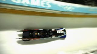 PARK CITY, UT - NOVEMBER 17: Nick Cunningham, Ryan Bailey, Christopher Kinney and Samuel Michener of the USA compete in the 4-Man Bobsled during the BMW IBSF Bobsleigh and Skeleton World Cup at Utah Olympic Park on November 17, 2017 in Park City, Utah.   Sean M. Haffey/Getty Images/AFP