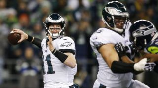 SEATTLE, WA - DECEMBER 03: Quarterback Carson Wentz #11 of the Philadelphia Eagles passes against the Seattle Seahawks in the first quarter at CenturyLink Field on December 3, 2017 in Seattle, Washington.   Otto Greule Jr /Getty Images/AFP