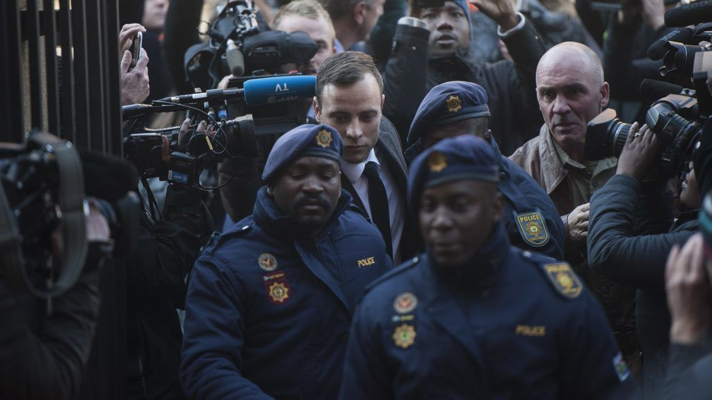 PRETORIA, SOUTH AFRICA - JULY 06:  South African Paralympic athlete Oscar Pistorius arrives with security at the North Gauteng High Court to attend summary judgement on his trial on July 6, 2016 in Pretoria, South Africa.The Paralympic athlete killed his girlfriend on Valentine's Day of 2013, when he fired a gun four times through a locked toilet door at his Pretoria home. Chris Jude / Anadolu Agency
