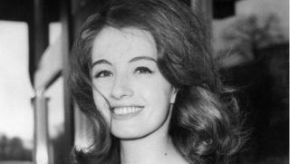 (FILES) This file photo taken on June 1, 1963 shows Christine Keeler, British model and call girl, appearing in court in London accused of living off immoral earnings and to have relationship with Dr Stephen Ward, osteopath and artist seen as the ringmaster of the sex and security circus. Christine Keeler, the model at the heart of the Profumo affair that scandalised 1960s Britain and almost brought down the government, has died aged 75, her son announced Tuesday, December 5, 2017. / AFP PHOTO / CENTRAL PRESS / -