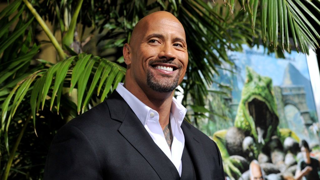 """LOS ANGELES, CA - FEBRUARY 02:  Actor Dwayne Johnson arrives at the premiere of Warner Bros. Pictures' """"Journey 2: The Mysterious Island"""" at the Chinese Theater on February 2, 2012 in Los Angeles, California.  (Photo by Kevin Winter/Getty Images)"""