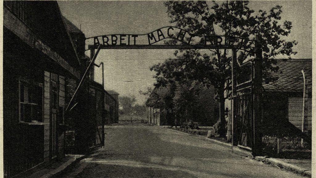 Auschwitz I concentration camp postcard - view of the metal sign reading 'Arbeit Mach Frei' - work makes you free. Caption reads: The Gateway of the Chief Camp'.  Source: Museum of O?wi?cim, Poland. -  Photos taken by guard or SS. Publication date of postcard not known.  Konzentrationslager Auschwitz Site of murdered Jews. (Photo by Culture Club/Getty Images)