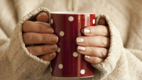 Lady holding a hot drink