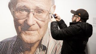A visitor takes a mobile photo of a picture of Ingvar Kamprad, founder of Swedish multinational furniture retailer IKEA, at the IKEA museum in Almhult, Sweden, on January 28, 2018. Ingvar Kamprad, the enigmatic founder of Swedish furniture giant IKEA, died aged 91 on Sunday, the company said. / AFP PHOTO / TT News Agency / Ola TORKELSSON / Sweden OUT