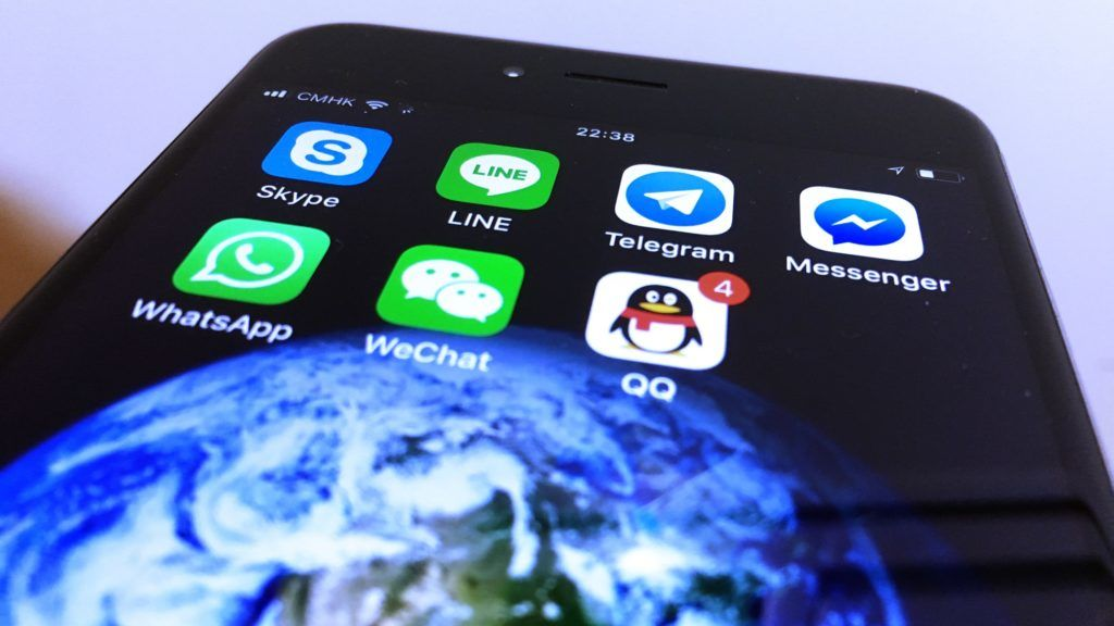 Instant messaging (IM) apps of Skype, LINE, Telegram, Messenger, WhatsApp, WeChat, QQ are seen on a phone.
