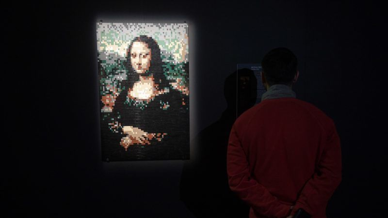 """3035715 02/22/2017 A visitor by Leonardo da Vinci's Mona Lisa picture made of LEGO on display at the exhibition """"LEGO Art"""" by Nathan Sawaya in Moscow. Grigoriy Sisoev/Sputnik"""