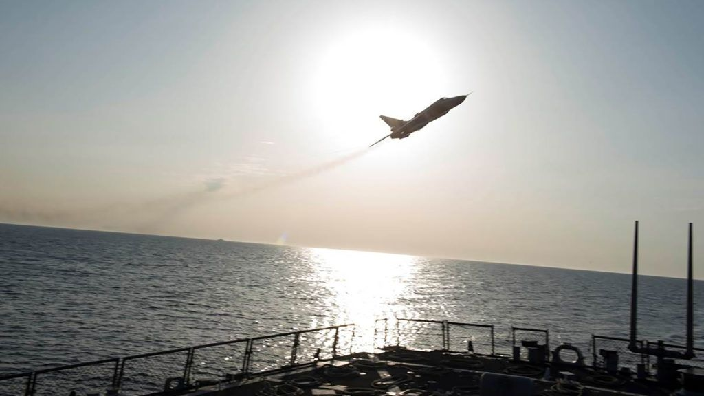"""A Russian Sukhoi Su-24 attack aircraft makes a very-low altitude pass by the USS Donald Cook (DDG 75),an Arleigh Burke-class guided-missile destroyer, operating in the Baltic Sea April 12, 2016.   A United States Navy Destroyer operating in international waters in the Baltic Sea experienced several close interactions by Russian aircraft on April 11 and 12. USS Donald Cook (DDG 75) encountered multiple, aggressive flight maneuvers by Russian aircraft that were performed within close proximity of the ship. On April 11, Donald Cook was conducting deck landing drills with an Allied military helicopter when two Russian SU-24 jets made numerous, close-range and low altitude passes at approximately 3 p.m. local. One of the passes, which occurred while the Allied helicopter was refueling on the deck of Donald Cook, was deemed unsafe by the ship's commanding officer. As a safety precaution, flight operations were suspended until the SU-24s departed the area. / AFP PHOTO / US NAVY 6TH FLEET / Handout / RESTRICTED TO EDITORIAL USE - MANDATORY CREDIT """"AFP PHOTO / US NAVY 6th FLEET"""" - NO MARKETING NO ADVERTISING CAMPAIGNS - DISTRIBUTED AS A SERVICE TO CLIENTS"""