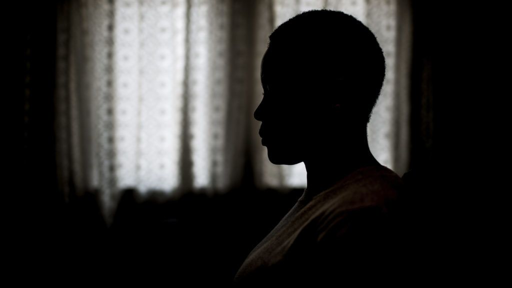 South African chef Nthabiseng Mabuza (pseudonym), 35 years old, sits at home on July 7, 2017, in Vosloorus, a middle-class township east of Johannesburg, after telling about her rape by the driver of a public mini-bus taxi, while she was on her way to work, two years ago. Her alleged attacker was arrested at the scene after she shouted for help to a passerby who flagged down a police patrol car. Although the suspect was held in custody for several months, he was later freed on bail. Two years on, the case has not yet come to court and the accused has vanished.  / AFP PHOTO / GULSHAN KHAN