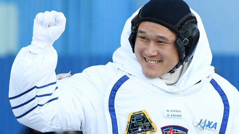 Member of the International Space Station (ISS) expedition 53/54, Norishige Kanai of the Japan Aerospace Exploration Agency (JAXA), waves during a send-off ceremony at the Russian-leased Baikonur Cosmodrome in Kazakhstan early on December 17, 2017. NASA astronaut Scott Tingle and crewmates Anton Shkaplerov of the Russian space agency Roscosmos and Norishege Kanai of the Japan Aerospace Exploration Agency were expected to lift off in the Soyuz MS-07 spacecraft from the Baikonur Cosmodrome. / AFP PHOTO / Kirill KUDRYAVTSEV