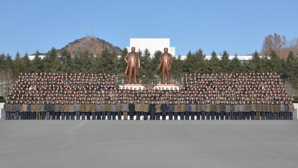 """This undated picture released from North Korea's official Korean Central News Agency (KCNA) on January 12, 2018 shows North Korean leader Kim Jong-Un (C) and scientists posing for a group photo during his inspection to the State Academy of Sciences at an undisclosed location.  / AFP PHOTO / KCNA VIA KNS / STR / South Korea OUT / REPUBLIC OF KOREA OUT   ---EDITORS NOTE--- RESTRICTED TO EDITORIAL USE - MANDATORY CREDIT """"AFP PHOTO/KCNA VIA KNS"""" - NO MARKETING NO ADVERTISING CAMPAIGNS - DISTRIBUTED AS A SERVICE TO CLIENTS THIS PICTURE WAS MADE AVAILABLE BY A THIRD PARTY. AFP CAN NOT INDEPENDENTLY VERIFY THE AUTHENTICITY, LOCATION, DATE AND CONTENT OF THIS IMAGE. THIS PHOTO IS DISTRIBUTED EXACTLY AS RECEIVED BY AFP.  /"""