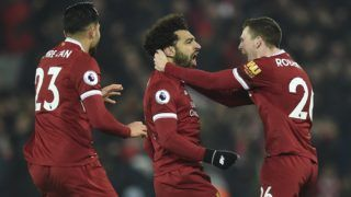 Liverpool's Egyptian midfielder Mohamed Salah (C) celebrates scoring their fourth goal to make the score 4-1 with team-mates Liverpool's Scottish defender Andrew Robertson (R) and Liverpool's German midfielder Emre Can (L) during the English Premier League football match between Liverpool and Manchester City at Anfield in Liverpool, north west England on January 14, 2018. / AFP PHOTO / Oli SCARFF / RESTRICTED TO EDITORIAL USE. No use with unauthorized audio, video, data, fixture lists, club/league logos or 'live' services. Online in-match use limited to 75 images, no video emulation. No use in betting, games or single club/league/player publications.  /