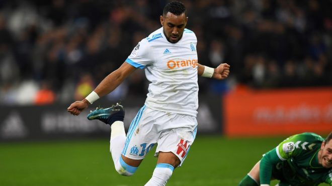 Olympique de Marseille's French forward Dimitri Payet scores a goal during the French L1 football match Marseille vs Strasbourg on January 16, 2018 at the Velodrome stadium in Marseille, southern France.  / AFP PHOTO / ANNE-CHRISTINE POUJOULAT