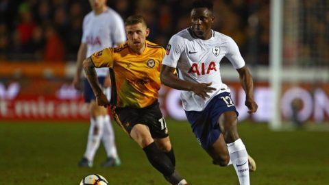 Newport County's English defender Scot Bennett and Tottenham Hotspur's Kenyan midfielder Victor Wanyama (R) chase the ball during the English FA Cup fourth round football match between Newport County and Tottenham Hotspur at Rodney Parade in Newport, in south Wales, on January 27, 2018. / AFP PHOTO / Geoff CADDICK / RESTRICTED TO EDITORIAL USE. No use with unauthorized audio, video, data, fixture lists, club/league logos or 'live' services. Online in-match use limited to 75 images, no video emulation. No use in betting, games or single club/league/player publications.  /