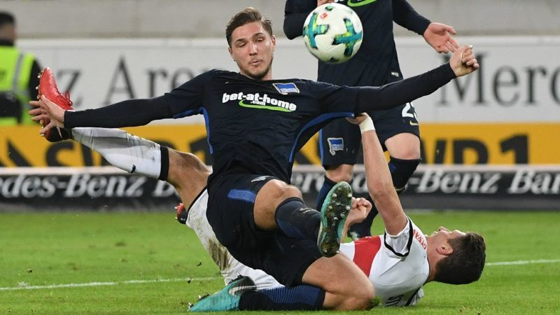 Stuttgart's Mario Gomez (bottom) and Berlin's Niklas Stark in action during the German Bundesliga football match between VfB Stuttgart and Hertha BSC at the Mercedes-Benz-Arena in Stuttgart, Germany, 13 Janaury 2018.  (EMBARGO CONDITIONS - ATTENTION: Due to the accreditation guidelines, the DFL only permits the publication and utilisation of up to 15 pictures per match on the internet and in online media during the match.) Photo: Marijan Murat/dpa