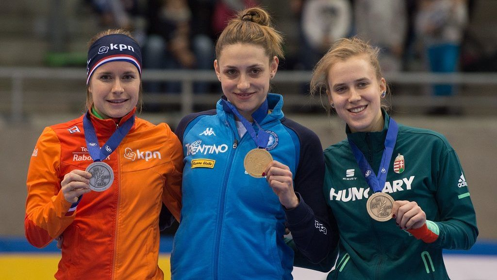 First runner-up Yara van Kerkhof (l-r) from the Netherlands, winner Martina Valcepina from Italy and second runner-up Sara Luca Bacskai from Hungary show their medals at the award ceremony after the women's 500m final of the Short Track Speed Skating European Championship in Dresden, Germany, 13 January 2013. Photo: Sebastian Kahnert/dpa