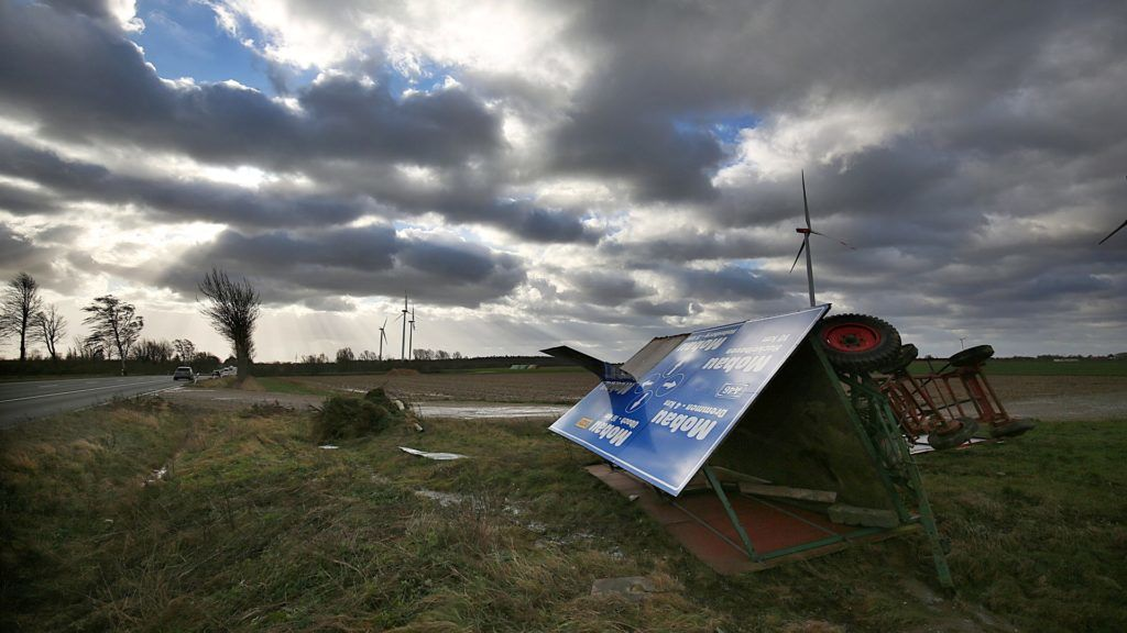 """Heavy wind has blown over two trailers with advertisement boards in Heinsberg, Germany, 18 January 2018. Germany prepares for the arrival of storm """"Friederike"""" as weather services issue warnings of gale-force winds. Photo: Oliver Berg/dpa"""