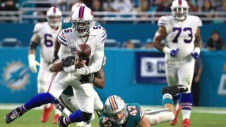 MIAMI GARDENS, FL - DECEMBER 31: Stephone Anthony #44 of the Miami Dolphins forces a fumble on Tyrod Taylor #5 of the Buffalo Bills during the second quarter against the Miami Dolphins at Hard Rock Stadium on December 31, 2017 in Miami Gardens, Florida.   Mike Ehrmann/Getty Images/AFP