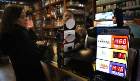 SAN FRANCISCO, CA - JANUARY 03: A customer purchases lottery tickets at a convenience store on January 3, 2018 in San Francisco, California. The Powerball jackpot and Mega Millions jackpots are both over $400 million at the same time for the first time. The Mega Millions $418 million jackpot would be the fourth largest and the $460 million Powerball jackpot would be the seventh largest in the game's history.   Justin Sullivan/Getty Images/AFP